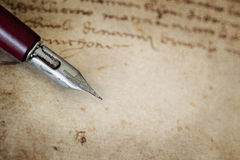 Vintage Nib Pen over Grunge Text Royalty Free Stock Photo