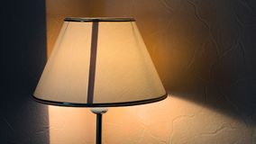 Vintage night lamp on the table with warm yellow light royalty free stock photo