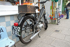 Vintage norman nippy motorcycle. Photo of rear detail of vintage 1950's british norman nippy moped parked outside kent shop Stock Image