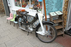 Vintage norman nippy motorcycle. Photo of vintage 1950's british norman nippy moped parked outside kent shop Stock Photo