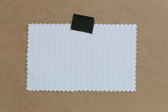 Vintage of note paper on brown background and copy specs. Royalty Free Stock Photography