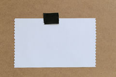 Vintage of note paper on brown background and copy specs. Stock Photo