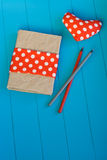 Vintage notebook, heart with red polka dot fabric Stock Photography