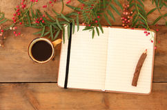Vintage notebook, old paper and stack of colorful wooden pencil next to cup of coffee over wooden table. ready for mockup Royalty Free Stock Photos