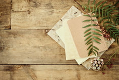 Vintage notebook, old paper and stack of colorful wooden pencils over wooden table. ready for mockup Stock Photography