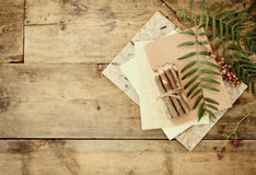 Vintage notebook, old paper and stuck of colorful wooden pencil over wooden table. ready for mockup Royalty Free Stock Photos