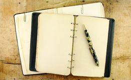Vintage Notebook and Pen Stock Photo