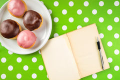 Vintage notebook with recipe for delicious homemade donuts with Stock Photos