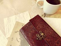 Vintage Notebook and Tea royalty free stock image