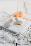 Vintage notebook on white table. Vintage handmade Notepad on a white table cloth and beads from pearls Royalty Free Stock Images