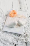 Vintage notebook on white table. Vintage handmade Notepad on a white table cloth and beads from pearls Royalty Free Stock Photos