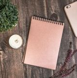 Vintage notebook on wooden table royalty free stock photography