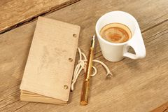 Vintage Notepad, Golden Fountain Pen and Cup of Espresso on Wood Royalty Free Stock Photos