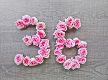 36 - vintage number of pink roses on the background of dark wood5 stock images
