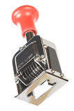 Vintage numbering machine. Vintage automatic numbering machine on white Stock Photography