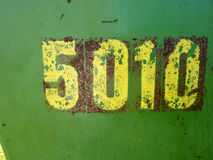 Numbers retro. Stenciled numbers on a green rusting and peeling metal steel sheet. Useful to incorporate into new collage or design led projects or to use in Royalty Free Stock Photo