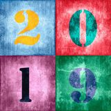 2019, vintage numbers on textured colorful background. 2019, vintage numbers on grunge textured colorful background stock photo
