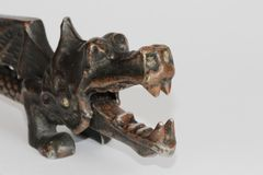 Vintage nutcracker in the shape of dragon stock photo