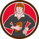Vintage NZ Rugby Player Hold Ball Circle Cartoon. Illustration of a vintage original rugby player wearing black uniform holding ball facing front set inside Stock Images