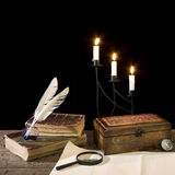 Vintage objects. Still life of vintage objects with candle,  trunk and old book Royalty Free Stock Photo
