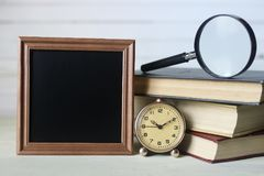 Frame for text books and watch. Vintage objects in the composition of the concept of nostalgia of the past Stock Photography