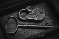 Vintage objects - a key and a lock. Real Antiques Stock Photo