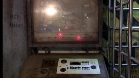 Vintage obsolete computer with map and red and green lights on it, communication microphone and few broken buttons on the control