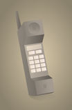 Vintage obsolete mobile phone on sepia picture Royalty Free Stock Photo