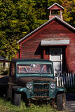 Vintage Off Road Vehicle and Red Schoolhouse - Vermont Stock Photo