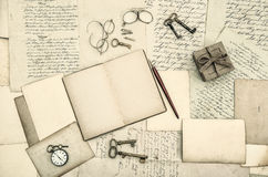 Vintage office accessories, book, handwritten letters Stock Photos