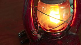 Vintage oil lamp antique stands on the table in the dark. royalty free stock photography