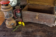 Vintage oil lamp ,old wooden box ,dry chrysanthemum flower Royalty Free Stock Photo