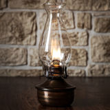 Vintage oil lamp on wooden table Stock Photography