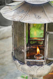 Vintage oil lantern lamp burning with glow light Royalty Free Stock Images