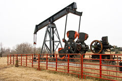 Vintage Oil Pump Unit. This 1938 model oil pumping unit has been reduced to pumping out the last ruminates of this scraper oil well site.  Repair parts are now Royalty Free Stock Photography