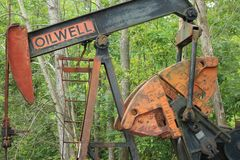 Vintage oil well in a wooded area stock photos