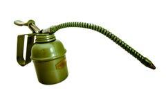 Vintage oiler with flexible spout. Vintage hand held oiler with flexible spout stock photos