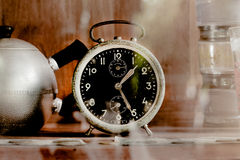 Vintage old alarm clock in glass closet Royalty Free Stock Photos