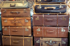 Vintage old battered leather suitcases Stock Images