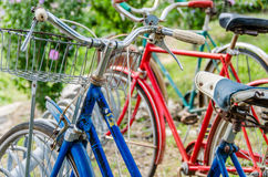 Vintage old bicycles. Vintage old classic bikes bicycles parked in a bike rack in a line Stock Photos