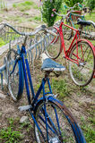 Vintage old bicycles. Vintage old retro classic bikes bicycles parked in a bike rack in a line Royalty Free Stock Images