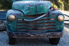 Vintage really old blue, green turquoise truck parked by the road stock photography