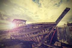 Vintage Old Boat on Junk Yard. Stock Photo