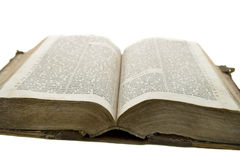 Vintage old book bible open for reading. Isolated on white Stock Photos