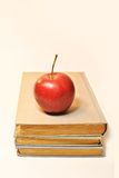 Vintage old books with red apple royalty free stock photo