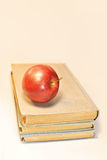 Vintage old books with red apples Royalty Free Stock Photo