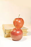 Vintage old books with red apples Stock Photos