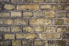 Vintage old brick yellow wall texture. Urban city street brick wall Stock Images