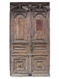 Vintage old brown wood door with patterns isolated Royalty Free Stock Images