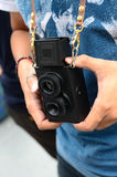 Vintage old camera 2 lens and hands  holding Stock Photography